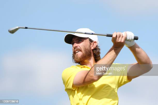 Tommy Fleetwood of England plays his shot from the fourth tee during the final round of the Honda Classic at PGA National Resort and Spa Champion...