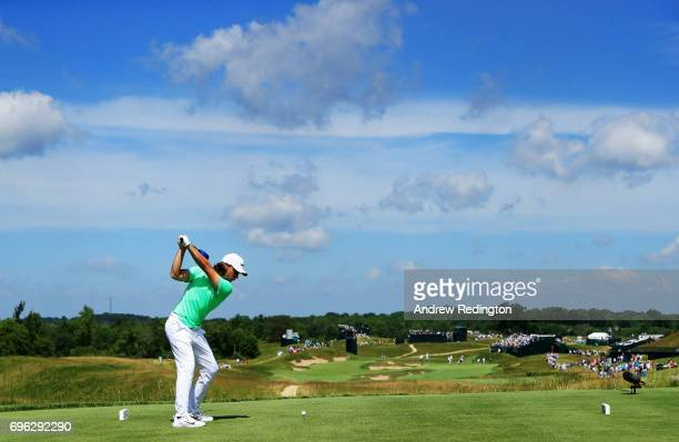 Tommy Fleetwood of England plays his shot from the fourth tee during the first round of the 2017 US Open at Erin Hills on June 15 2017 in Hartford...