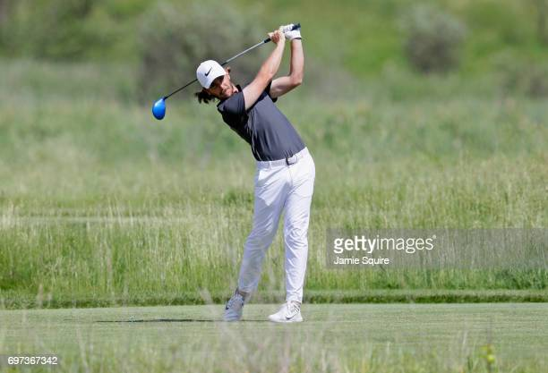 Tommy Fleetwood of England plays his shot from the second tee during the final round of the 2017 US Open at Erin Hills on June 18 2017 in Hartford...
