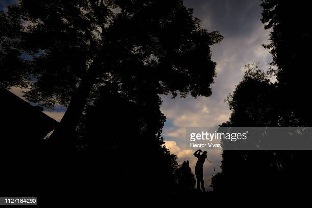 Tommy Fleetwood of England plays his shot on the 11th hole during the final round of World Golf Championships-Mexico Championship at Club de Golf...