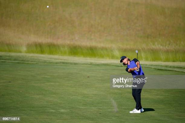 Tommy Fleetwood of England plays his shot on the 14th hole during the second round of the 2017 U.S. Open at Erin Hills on June 16, 2017 in Hartford,...