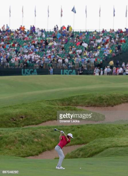 Tommy Fleetwood of England plays his shot on the 18th hole during the third round of the 2017 US Open at Erin Hills on June 17 2017 in Hartford...