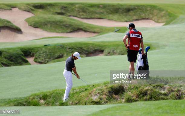 Tommy Fleetwood of England plays his shot on the fourth hole during the final round of the 2017 US Open at Erin Hills on June 18 2017 in Hartford...