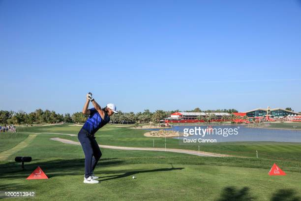 Tommy Fleetwood of England plays his tee shot on the 18th hole during the final round of the Abu Dhabi HSBC Championship at Abu Dhabi Golf Club on...