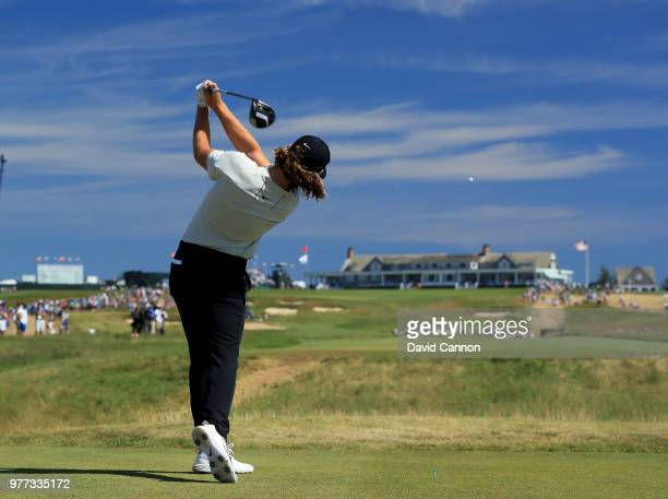 Tommy Fleetwood of England plays his tee shot on the 18th hole on his way to scoring a seven under par 63 and ultimate second place by one shot to...