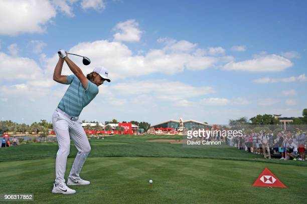 Tommy Fleetwood of England plays his tee shot on the par 4 ninth hole during the first round of the 2018 Abu Dhabi HSBC Golf Championship at the Abu...
