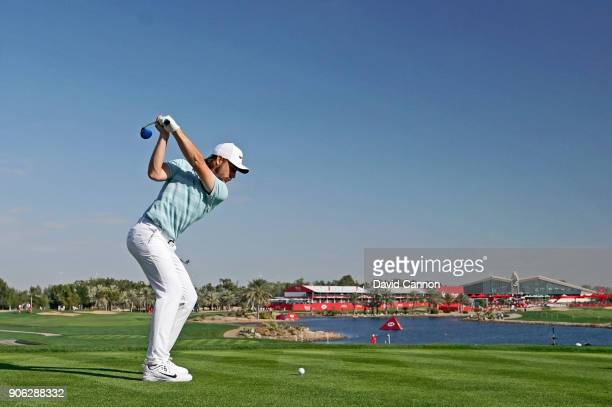 Tommy Fleetwood of England plays his tee shot on the par 5 18th hole during the first round of the 2018 Abu Dhabi HSBC Gof Championship at the Abu...