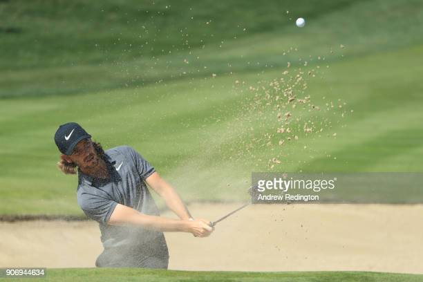 Tommy Fleetwood of England plays his third shot from a bunker on the second hole during round two of the Abu Dhabi HSBC Golf Championship at Abu...