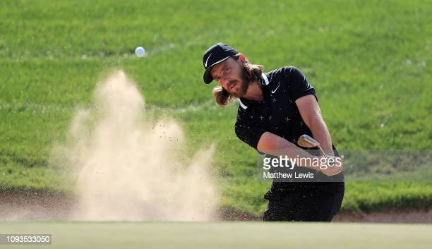 Tommy Fleetwood of England plays out of a bunke ron the 3rd hole during a practice round ahead of the Abu Dhabi HSBC Golf Championship at the Abu...