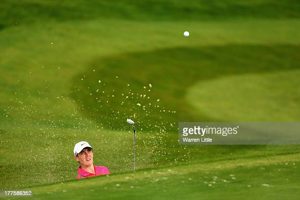 Tommy Fleetwood of England plays out of the 18th greenside bnunker during the third round of the Johnnie Walker Championship at Gleneagles on August...