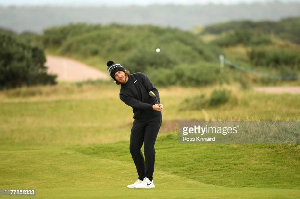 Tommy Fleetwood of England plays their second shot on the 9th hole during Day four of the Alfred Dunhill Links Championship at The Old Course on...