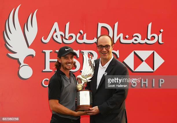 Tommy Fleetwood of England poses for photographs with Giles Morgan Head of Sponsorship Events at HSBC after winning the tournament during the final...