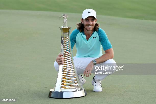 Tommy Fleetwood of England poses with the Race to Dubai trophy after the final round of the 2017 DP World Tour Championship on the Earth Course at...