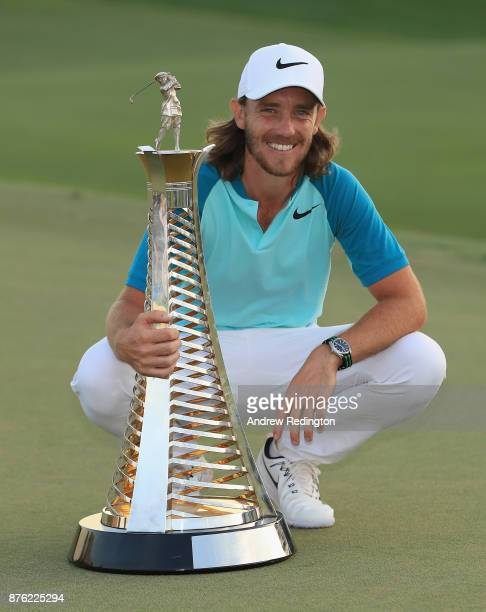 Tommy Fleetwood of England poses with the Race to Dubai trophy after the final round of the DP World Tour Championship at Jumeirah Golf Estates on...
