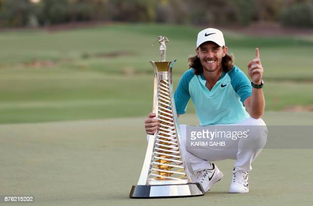 Tommy Fleetwood of England poses with the Race to Dubai trophy at the end of the final round of the DP World Tour Golf Championship at Jumeirah Golf...