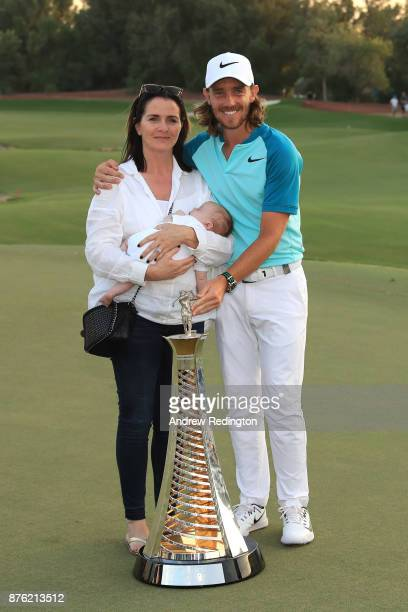 Tommy Fleetwood of England poses with the Race to Dubai trophy partner Clare Craig and son Franklin during the final round of the DP World Tour...