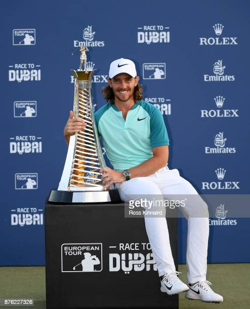 Tommy Fleetwood of England poses with the Race to Dubai trophy during the final round of the DP World Tour Championship at Jumeirah Golf Estates on...