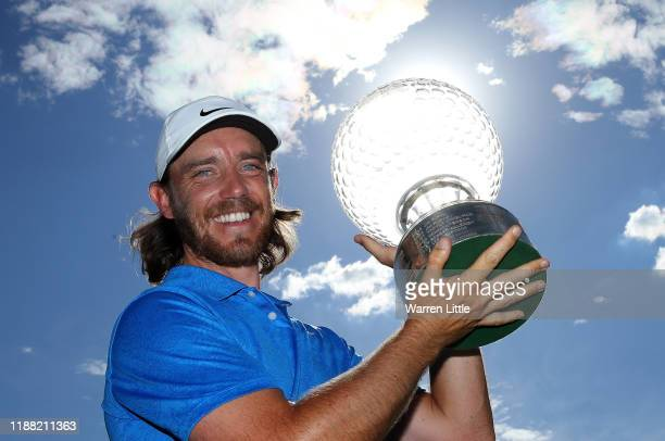 Tommy Fleetwood of England poses with the trophy after winning the Nedbank Golf Challenge hosted by Gary Player at the Gary Player CC on November 17,...