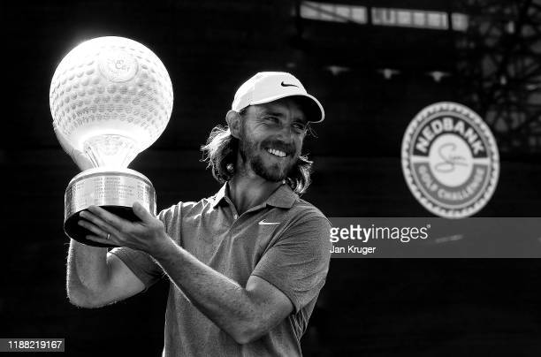 Tommy Fleetwood of England poses with the trophy after winning the Nedbank Golf Challenge hosted by Gary Player at Gary Player CC on November 17,...
