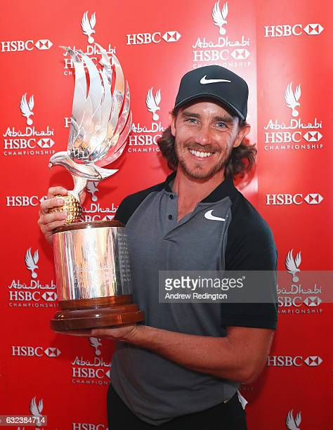 Tommy Fleetwood of England poses with the trophy after winning the tournament during the final round of the Abu Dhabi HSBC Championship at Abu Dhabi...