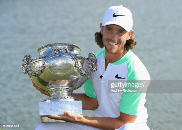 Tommy Fleetwood of England poses with the trophy after winning the HNA Open de France at Le Golf National on July 2 2017 in Paris France