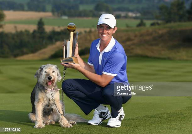 Tommy Fleetwood of England poses with the trophy and his dog Maisy after winning the Johnnie Walker Championship on the first extra hole in a three...