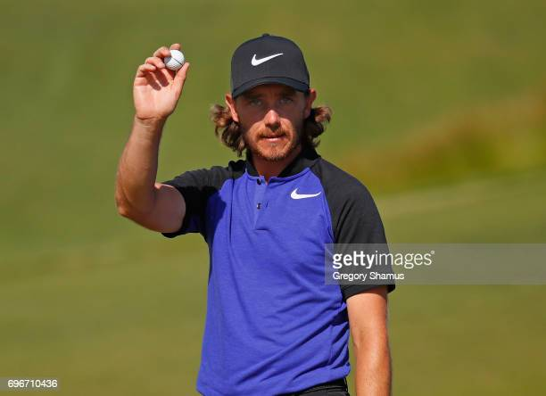 Tommy Fleetwood of England reacts after making a birdie on the 12th green during the second round of the 2017 US Open at Erin Hills on June 16 2017...