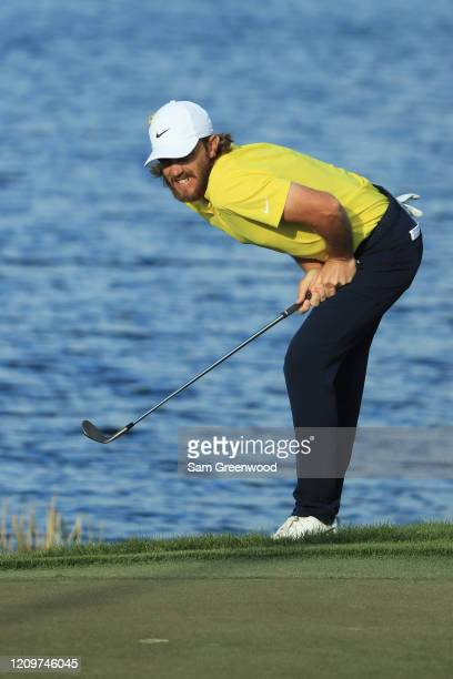 Tommy Fleetwood of England reacts to a shot on the 14th hole during the final round of the Honda Classic at PGA National Resort and Spa Champion...