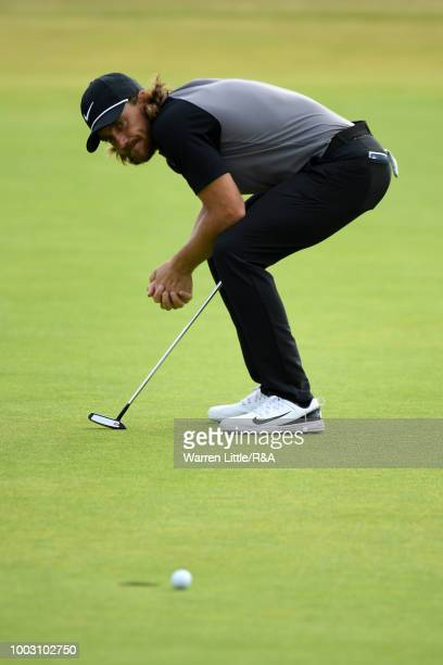 Tommy Fleetwood of England reacts to his missed birdie putt on the 18th hole green during round three of the Open Championship at Carnoustie Golf...
