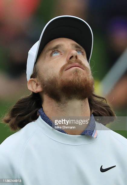 Tommy Fleetwood of England reacts to his missed eagle putt on the 12th green during the third round of The PLAYERS Championship on The Stadium Course...