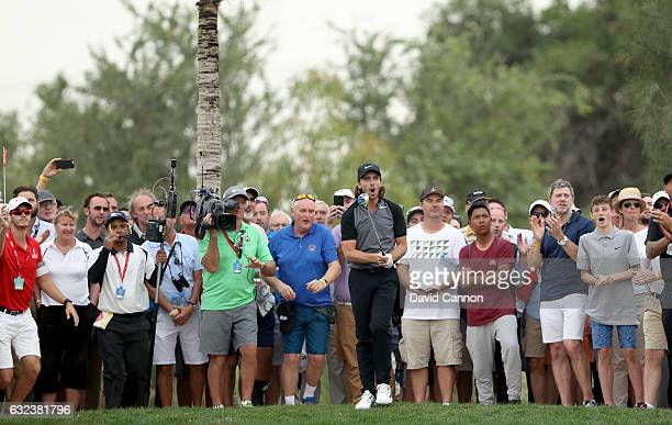 Tommy Fleetwood of England reacts to his second shot on the 18th hole during the final round of the 2017 Abu Dhabi HSBC Championship at Abu Dhabi...