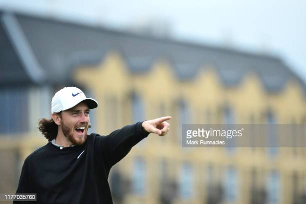 Tommy Fleetwood of England reacts to one of his playing partners shots during preview for the Alfred Dunhill Links Championship at The Old Course on...