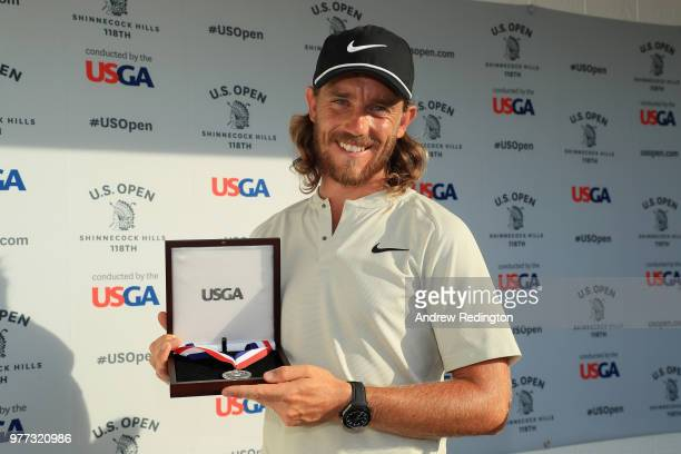 Tommy Fleetwood of England receives a medal after his 7under par 63 during the final round of the 2018 US Open at Shinnecock Hills Golf Club on June...