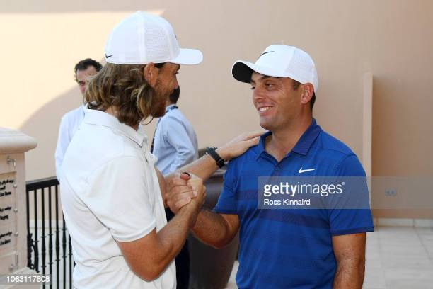 Tommy Fleetwood of England shakes hands with Francesco Molinari of Italy after Francesco Molinari wins the Race to Dubai during day four of the DP...