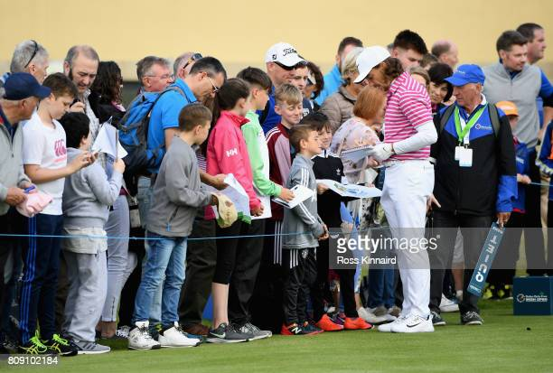 Tommy Fleetwood of England signs autographs on the 17th tee during the ProAm of the Dubai Duty Free Irish Open at Portstewart Golf Club on July 5...