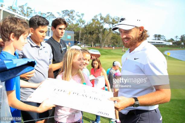 Tommy Fleetwood of England signs his autograph for fans during a practice round prior to The PLAYERS Championship on The Stadium Course at TPC...