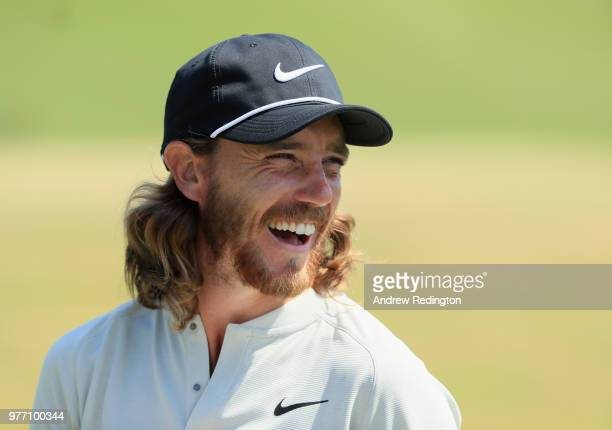 Tommy Fleetwood of England smiles after making a birdie putt on the 15th green during the final round of the 2018 U.S. Open at Shinnecock Hills Golf...