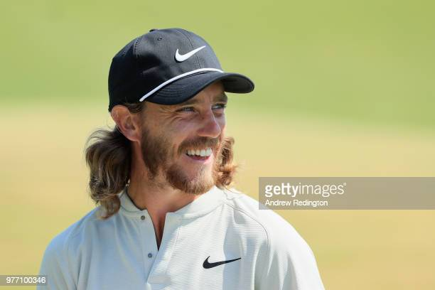 Tommy Fleetwood of England smiles after making a birdie putt on the 15th green during the final round of the 2018 US Open at Shinnecock Hills Golf...