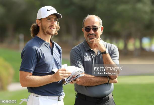 Tommy Fleetwood of England speaks to Abdulfattah Sharaf CEO of HSBC in the UAE during the proam prior to the Abu Dhabi HSBC Golf Championship at Abu...