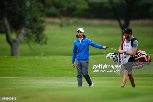 Tommy Fleetwood of England takes a club from his caddy during round two of the Hong Kong Open at the Hong Kong Golf Club on November 24 2017 / AFP...