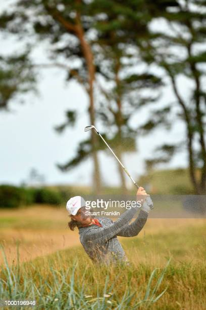 Tommy Fleetwood of England takes a shot on a practice round during previews ahead of the 147th Open Championship at Carnoustie Golf Club on July 16...