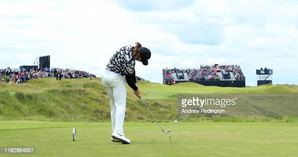 Tommy Fleetwood of England tees off the 16th during the second round of the 148th Open Championship held on the Dunluce Links at Royal Portrush Golf...