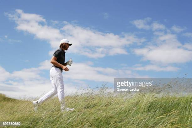 Tommy Fleetwood of England walks across the fifth hole during the final round of the 2017 US Open at Erin Hills on June 18 2017 in Hartford Wisconsin