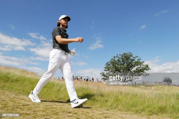 Tommy Fleetwood of England walks off the fifth hole during the final round of the 2017 US Open at Erin Hills on June 18 2017 in Hartford Wisconsin