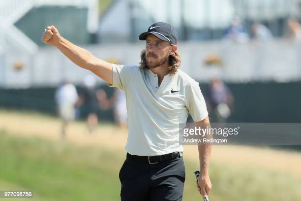 Tommy Fleetwood of England waves after making a birdie putt on the 15th green during the final round of the 2018 US Open at Shinnecock Hills Golf...