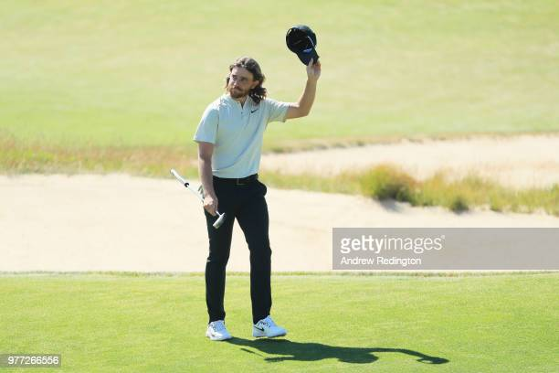 Tommy Fleetwood of England waves from on the 18th green during the final round of the 2018 US Open at Shinnecock Hills Golf Club on June 17 2018 in...