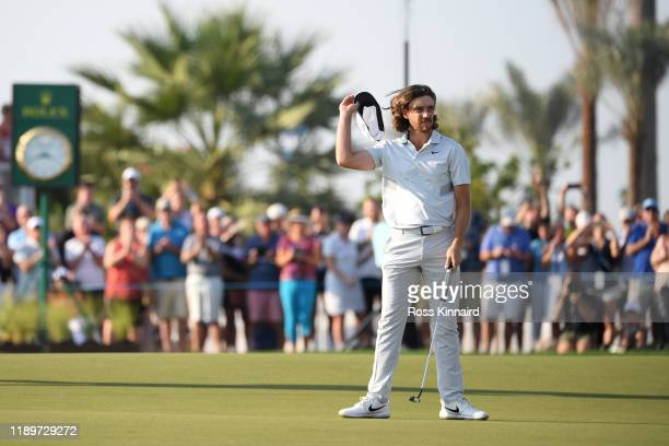 Tommy Fleetwood of England waves to the crowd on the eighteenth green during Day Four of the DP World Tour Championship Dubai at Jumerirah Golf...