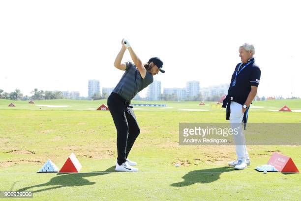 Tommy Fleetwood of England works with coach Alan Thompson on the range prior to round two of the Abu Dhabi HSBC Golf Championship at Abu Dhabi Golf...