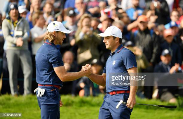 Tommy Fleetwood of Europe and Francesco Molinari of Europe celebrate on the 12th during the morning fourball matches of the 2018 Ryder Cup at Le Golf...