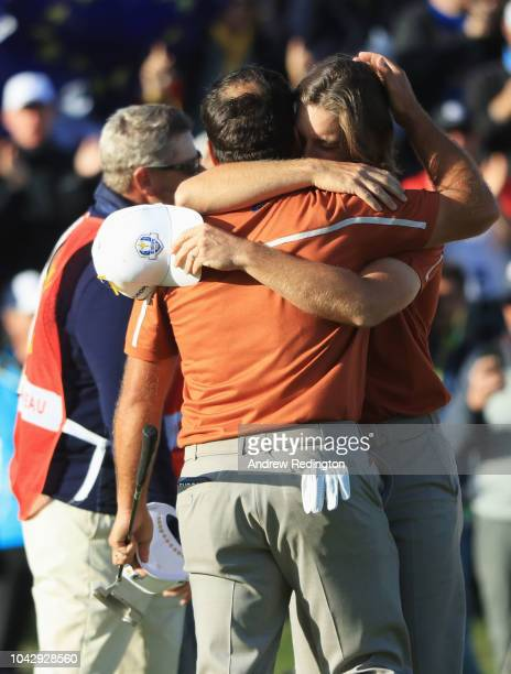 Tommy Fleetwood of Europe and Francesco Molinari of Europe celebrates winning their match on the 14th during the afternoon foursome matches of the...